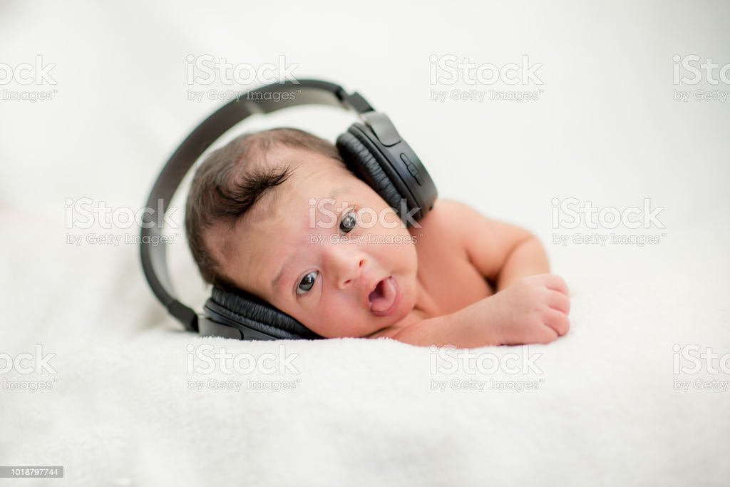 Cute Newborn Baby Hearing Music With Headphones On A Blanket Happy Family Moments Royalty