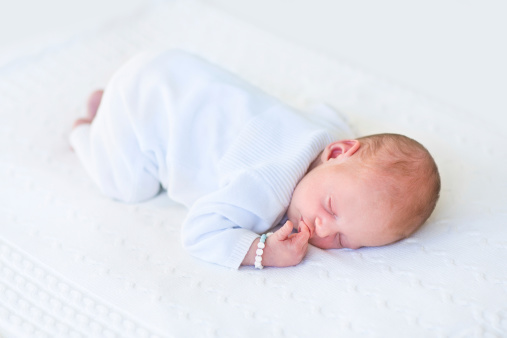 Cute Newborn Baby Sleeping On His Tummy At White Blanket ...