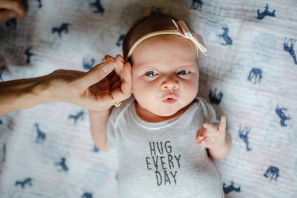 Cute newborn girl with parents and grandparents stock photo