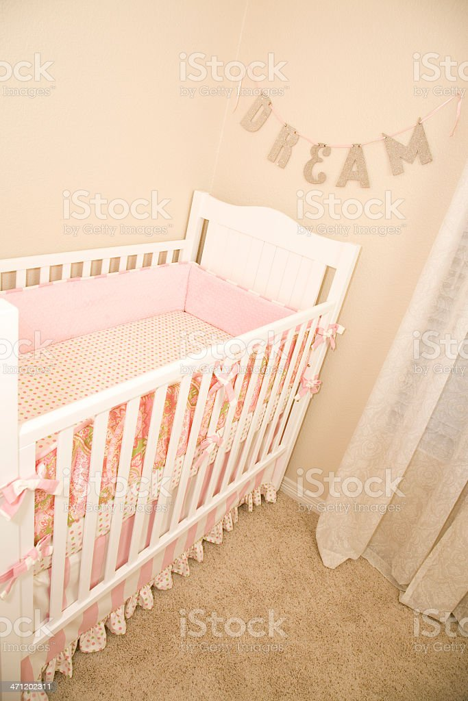 """Cute Nursery Bed with """"Dream"""" Above it royalty-free stock photo"""