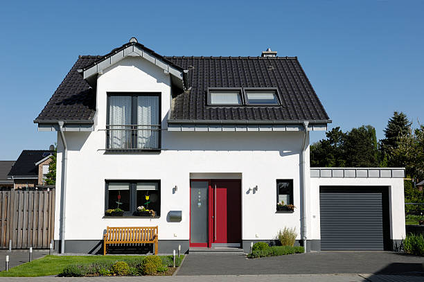 Cute one-family house with garage Typical one-familiy house. (Germany) detached house stock pictures, royalty-free photos & images