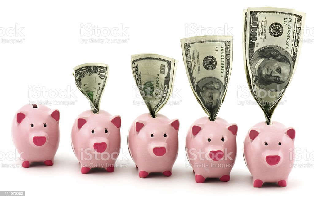 Cute Piggy Banks with Money royalty-free stock photo