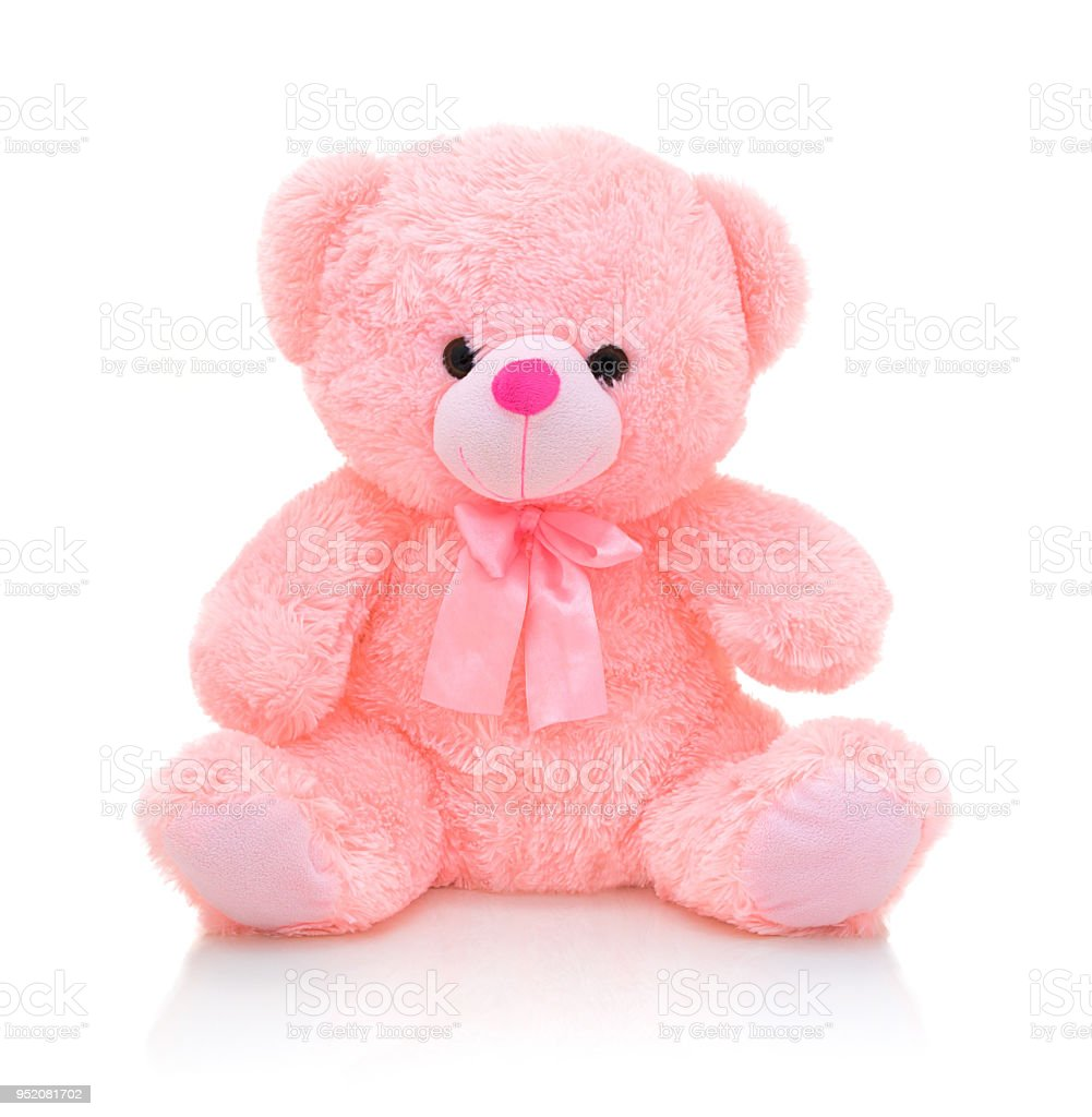 Cute pink bear doll with bow isolated on white background with shadow reflection. Playful bright pink bear sitting on white underlay. Teddy bear plush stuffed puppet with ribbon on white backdrop. stock photo