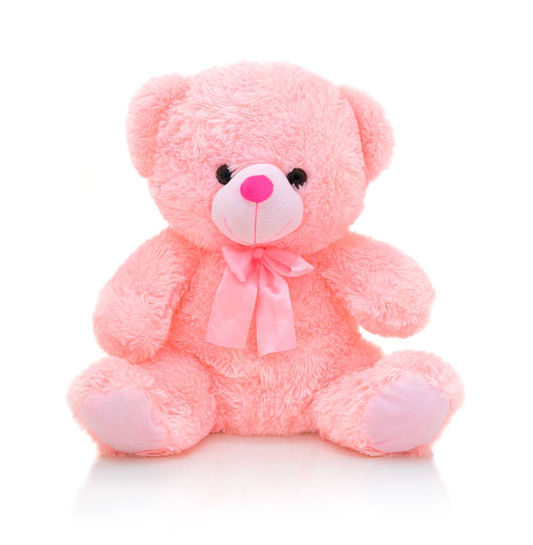 Cute pink bear doll with bow isolated on white background with shadow reflection. Playful bright pink bear sitting on white underlay. Teddy bear plush stuffed puppet with ribbon on white backdrop. Cute pink bear doll with bow isolated on white background with shadow reflection. Playful bright pink bear sitting on white underlay. Teddy bear plush stuffed puppet with ribbon on white backdrop. teddy bear stock pictures, royalty-free photos & images