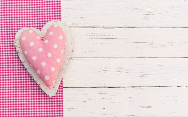 cute pink heart on white wooden background - its a girl stock photos and pictures