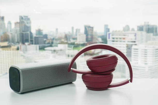 cute pink wireless headphone with bluetooth portable speaker on office desk for relaxation cute pink wireless headphone with bluetooth portable speaker on office desk for relaxation wireless headphones stock pictures, royalty-free photos & images