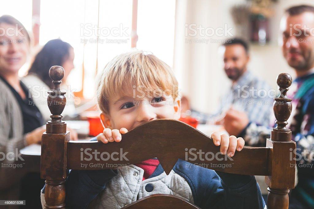 Cute Playful Preschooler Child at Christmas Dinner stock photo