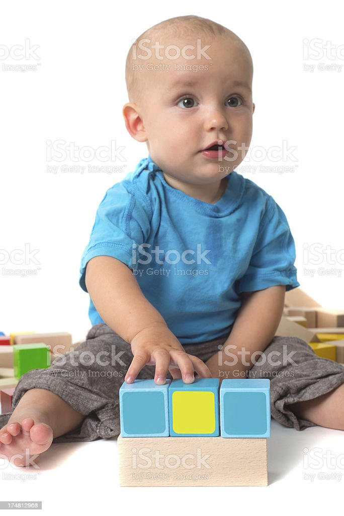 cute playing Baby with log of woods in studio stock photo
