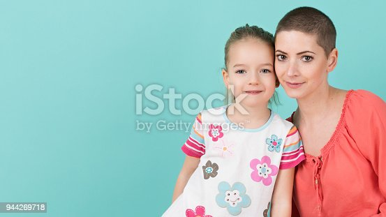 469949126 istock photo Cute preschool age girl with her mother, young cancer patient in remission. Cancer patient and family support concept. 944269718