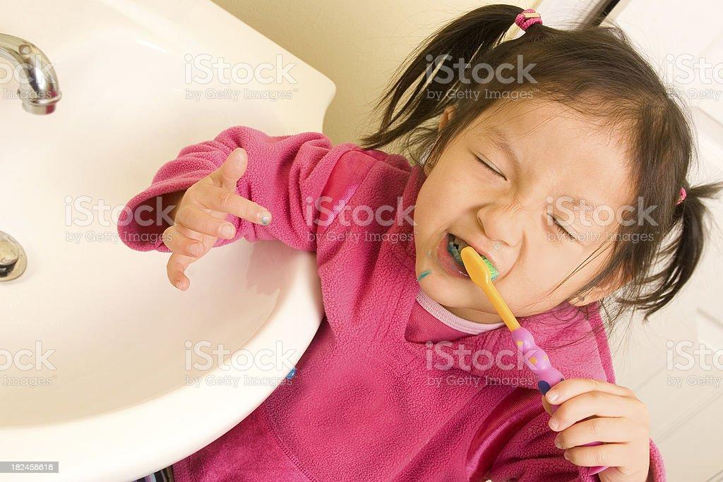 Cute preschooler brushing teeth royalty-free stock photo