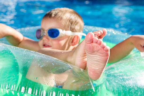 Cute Pre-Schooler Relaxing in the Pool stock photo