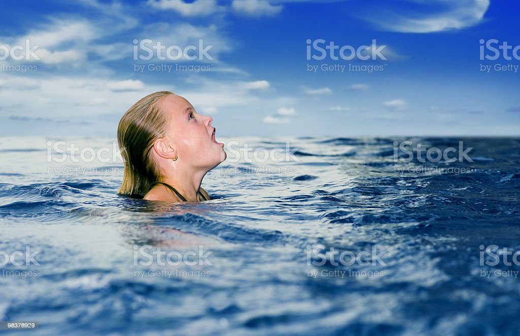 cute preteen in the ocean looking up royalty-free stock photo