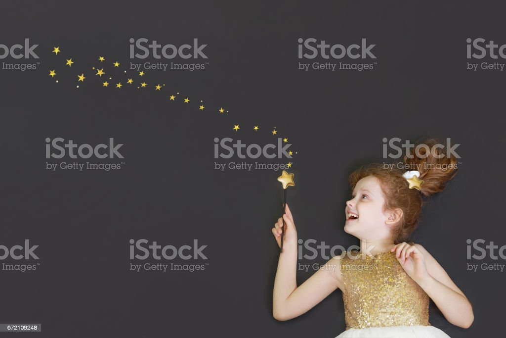 Cute princess girl dreaming on a  chalkboard stock photo