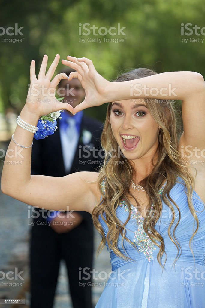 Cute Prom Couple Girl Framing Her Date With Heart Hands Stock ...