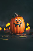 Cute pumpkin character with spider and handmade fangs
