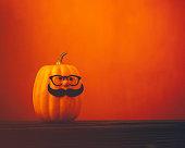 Cute pumpkin characters on bright orange background