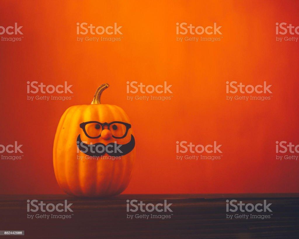 Cute pumpkin halloween characters on bright orange background stock photo