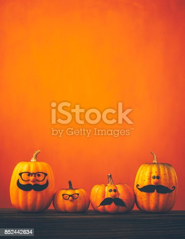 istock Cute pumpkin halloween characters on bright orange background 852442634