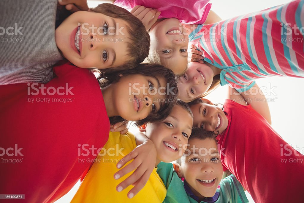 Cute pupils in a huddle stock photo