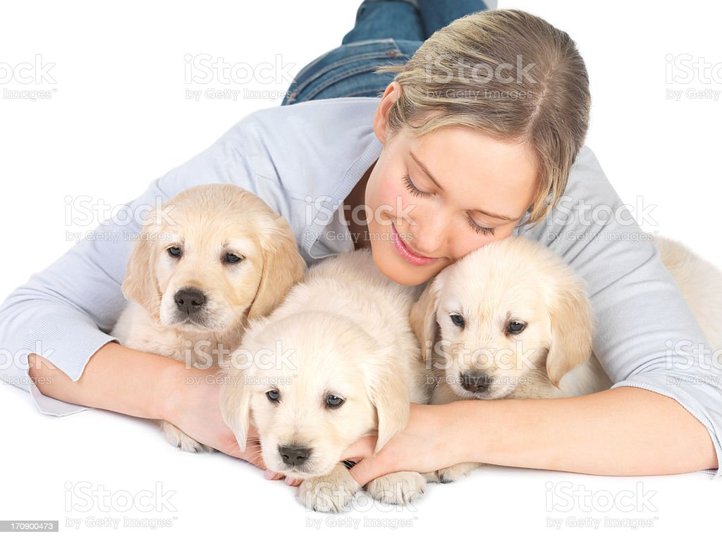 Cute puppies and young girl hugging royalty-free stock photo