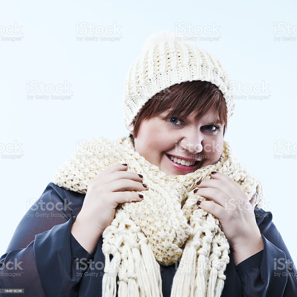 Cute readhead in knitted scarf royalty-free stock photo
