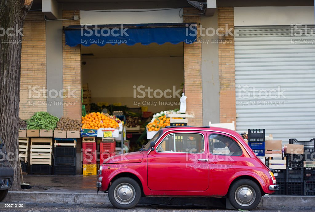Cute Red Vintage Car And Vegetable Market, Italy stock photo