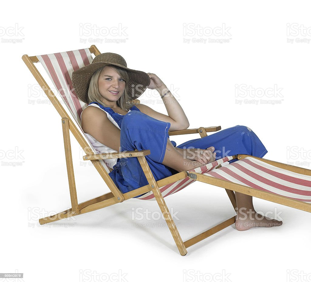 cute relaxing girl in a canvas chair royalty-free stock photo