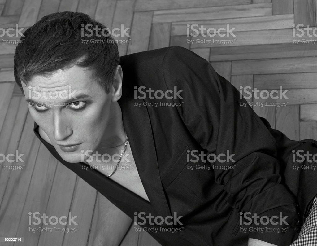 cute sad young guy looks up royalty-free stock photo