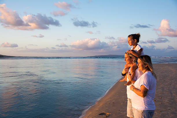 Cute same sex family watch the sunset stock photo