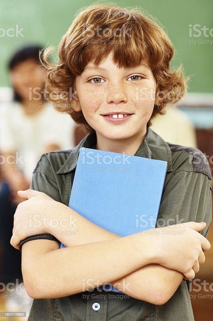 Cute school boy holding a book royalty-free stock photo