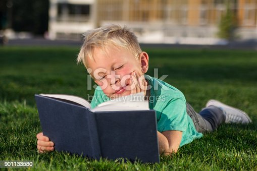 834369132 istock photo Cute schoolboy with books and a backpack 901133580