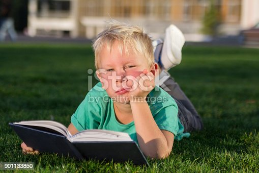 834369132 istock photo Cute schoolboy with books and a backpack 901133850