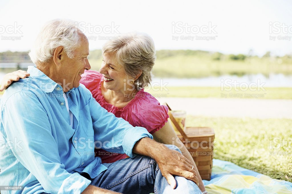 Cute senior couple looking at each other royalty-free stock photo