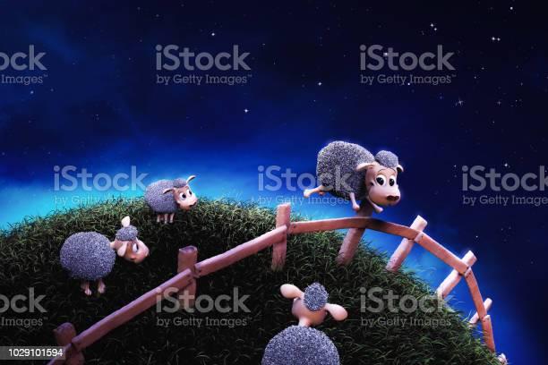 Photo of Cute sheep jumping a fence at night