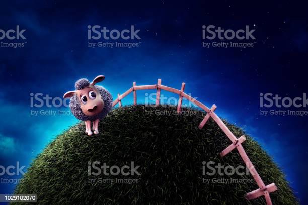 Cute sheep on grass next to a fence at night picture id1029102070?b=1&k=6&m=1029102070&s=612x612&h=kzikzs5myqes9 8cbr481dka ekfqmlndwmaf3rhfie=