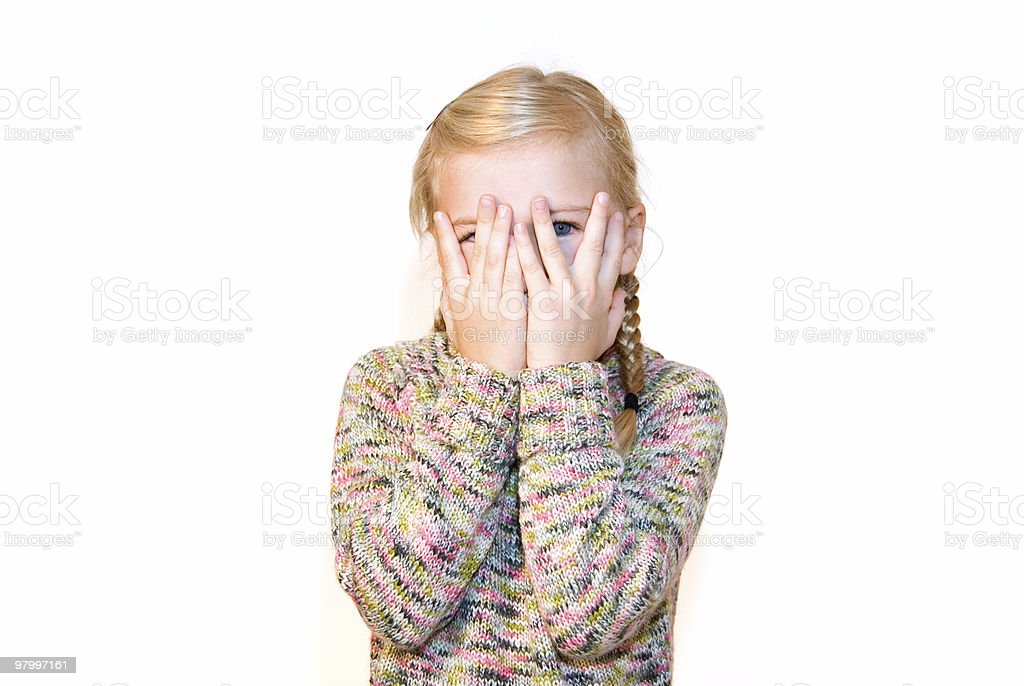 Cute shy little girl hiding her face royalty free stockfoto