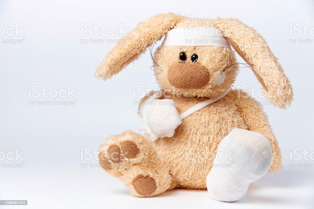 Cute sick bandaged hare stock photo