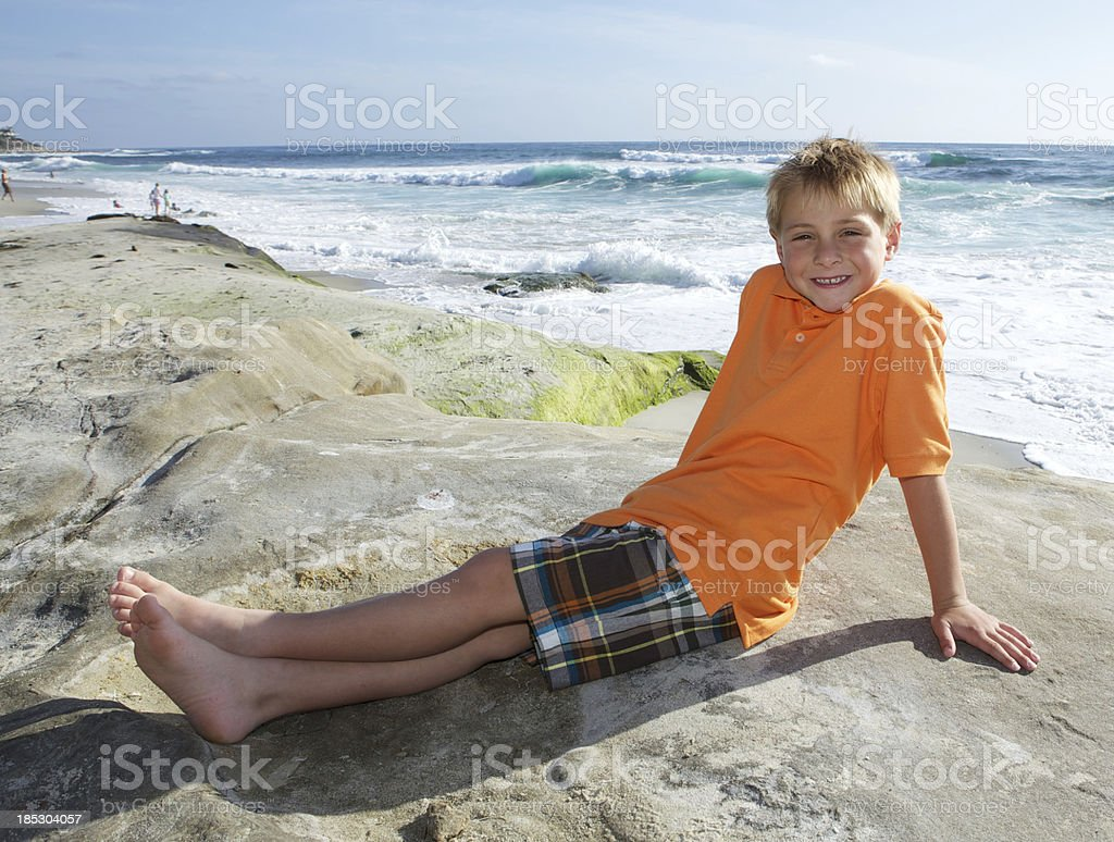 Cute Six Year Old Boy Portrait at the Beach stock photo