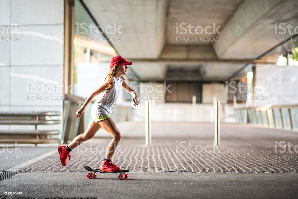 Cute skateboard girl stock photo