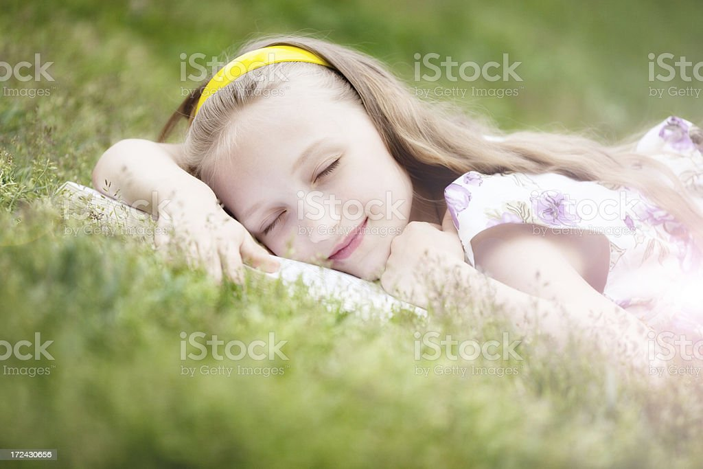 Cute Slipping  Girl Lying on the Book royalty-free stock photo