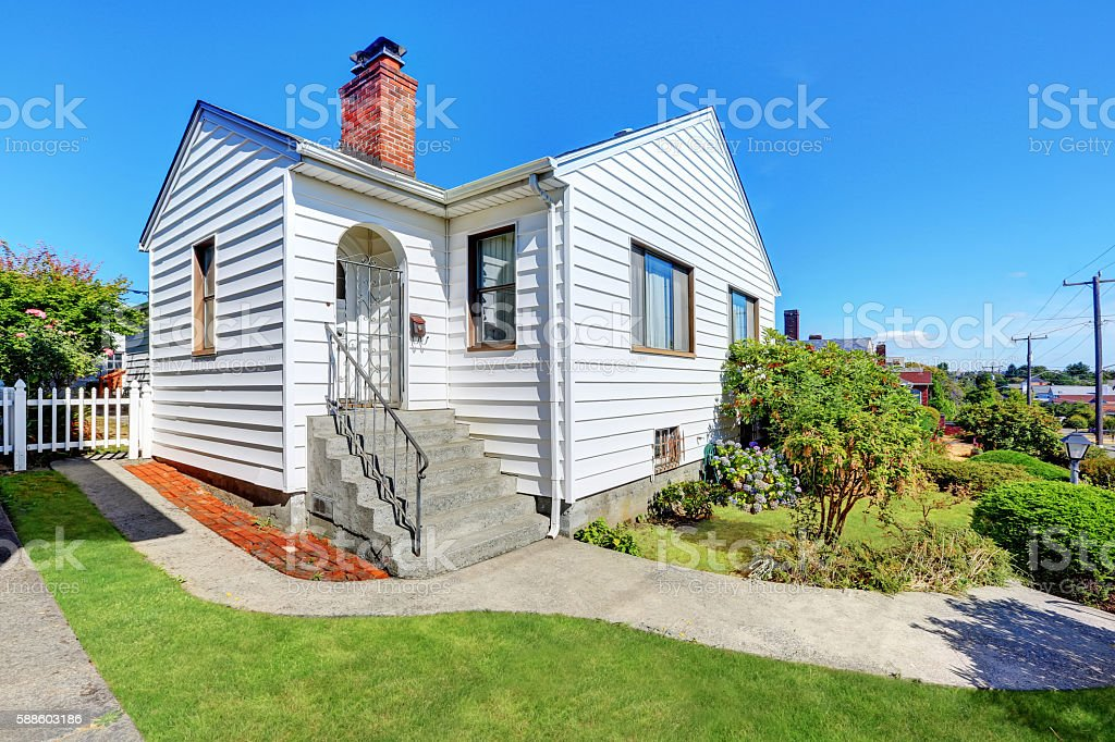 Cute small American house with white exterior paint stock photo