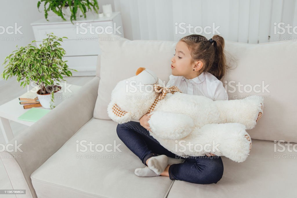 Marvelous Cute Small Girl Sitting On The Sofa In Lotos Position Squirreltailoven Fun Painted Chair Ideas Images Squirreltailovenorg