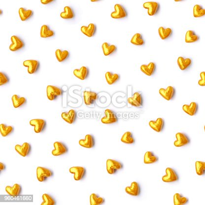 886746424istockphoto Cute small new modern 3D round isolated bright gold painted hearts objects on white paper background 960461660