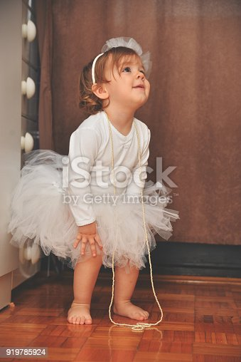 istock Cute small princess playing in bedroom 919785924