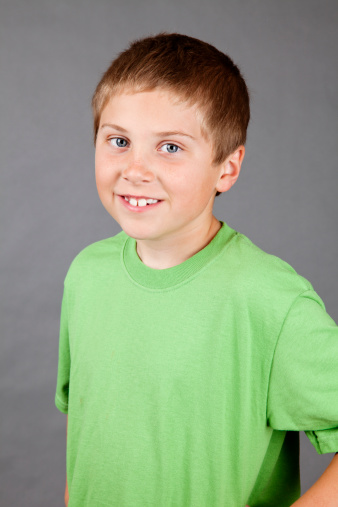 Cute Smiling 10year Old Boy On Grey Stock Photo More Pictures Of