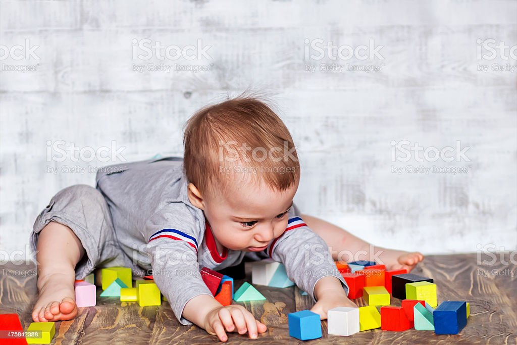 Cute Smiling Baby Boy With Colorful Wooden Bricks Stock Photo More