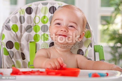 149051793 istock photo Cute smiling baby child enjoy eating watermelon 467318334