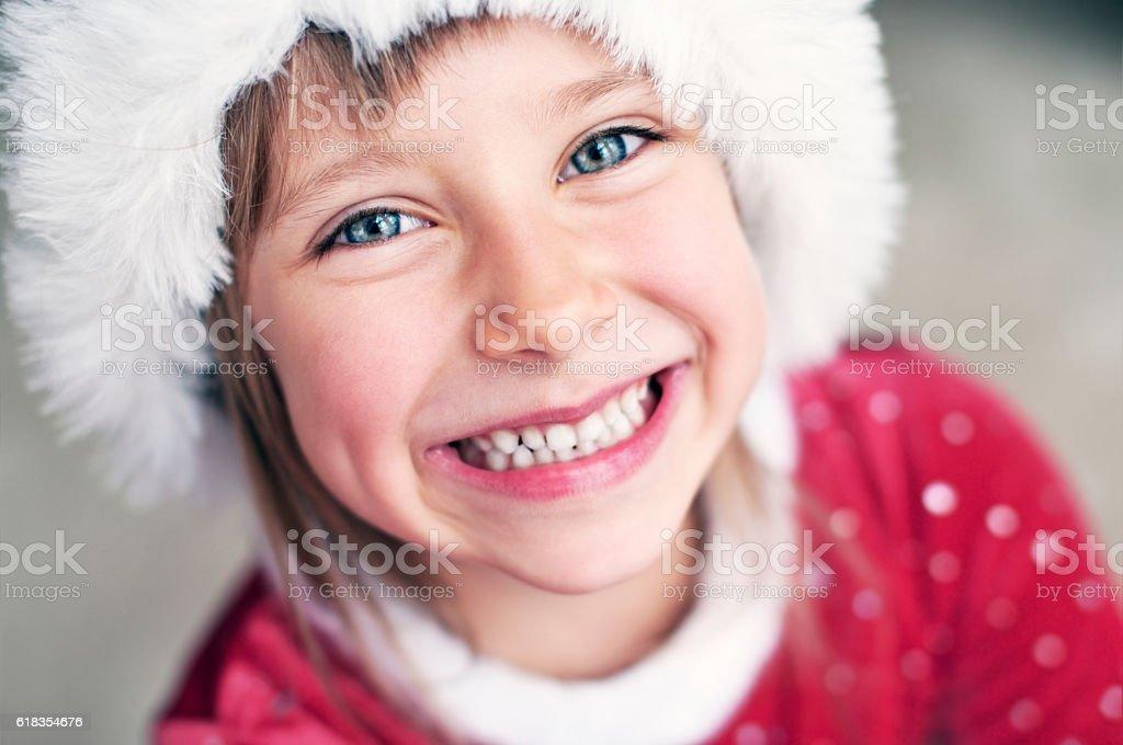 Cute smiling little girl dressed as santa helper stock photo