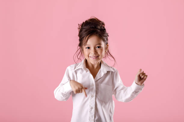 fe0359e7f4641 Royalty Free Smiling Girl Pointing Finger Away Isolated Pictures ...