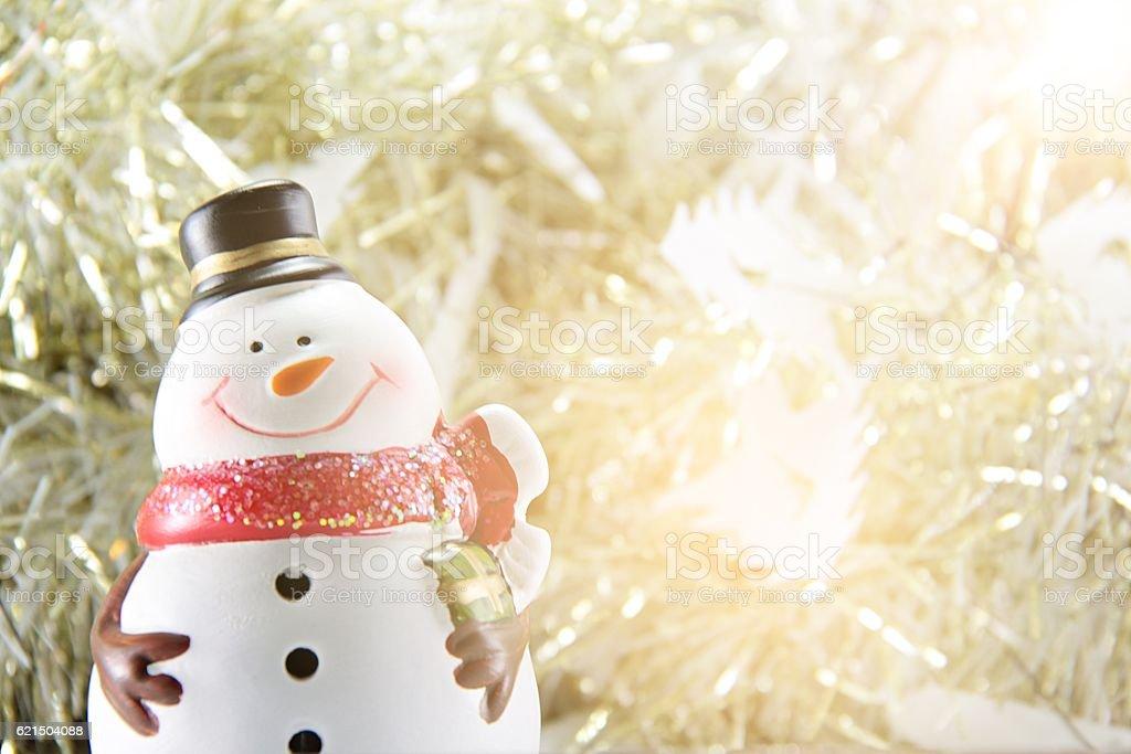 Cute snowman on gold streamer or tinsel background Lizenzfreies stock-foto